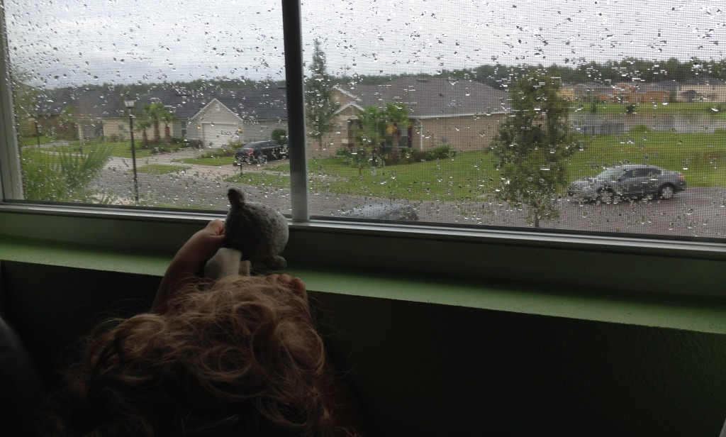 Micah shows Lamby the rain outside.