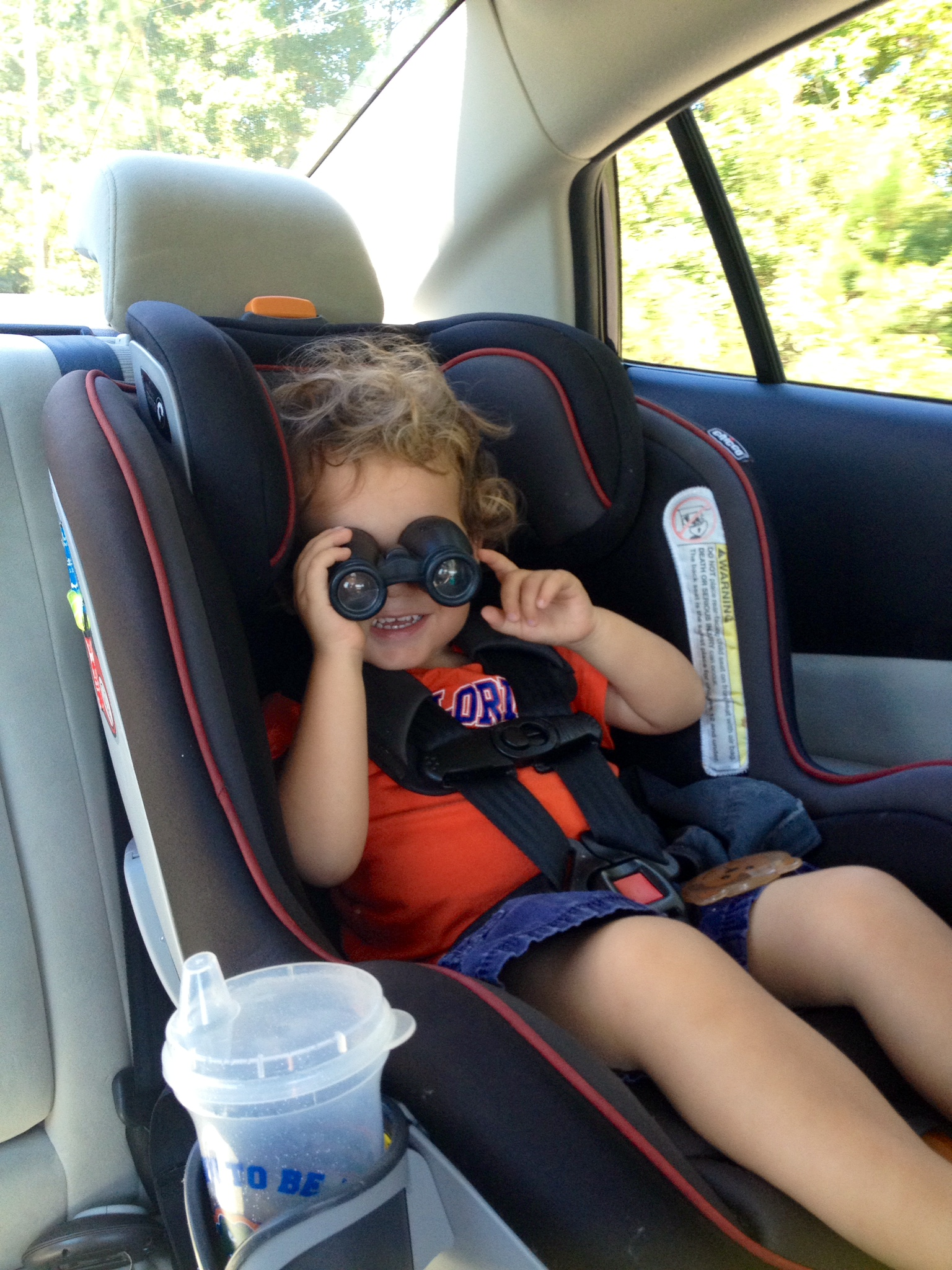 "Micah using his ""bonculars"" (binoculars)"